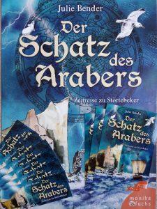 """Poster, Buchkarten und Lesezeichen des Kinderbuchs """"Der Schatz des Arabers"""" von Julie Bender."""